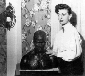 1952 publicity photo for the Canada Lee Foundation of Frances Lee posing with a bust of Canada Lee.