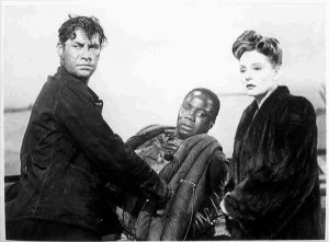 Photo showing, from L to R, John Hodiak, Canada Lee and Tallulah Bankhead, in a scene from the film 'Lifeboat', directed by Alfred Hitchcock.
