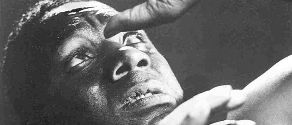 Photo of Canada Lee with his hands above his face (during production of Native Son). From a photo series by Fritz Hende.